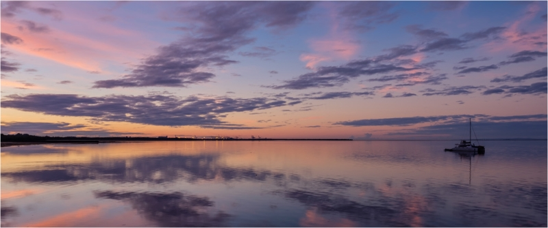 Merit For Reflected Sunset From Wynnum Jetty By Russell Dickson