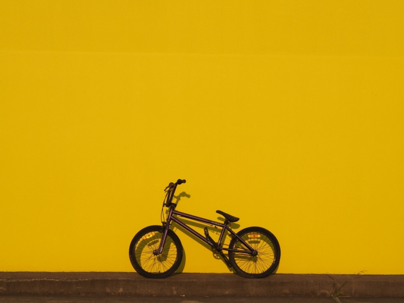 Honour For Purple Bike Yellow Wall By Trudi Aykens